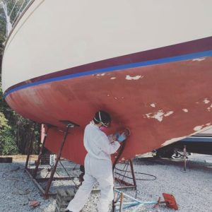 Michael grinding the hull.