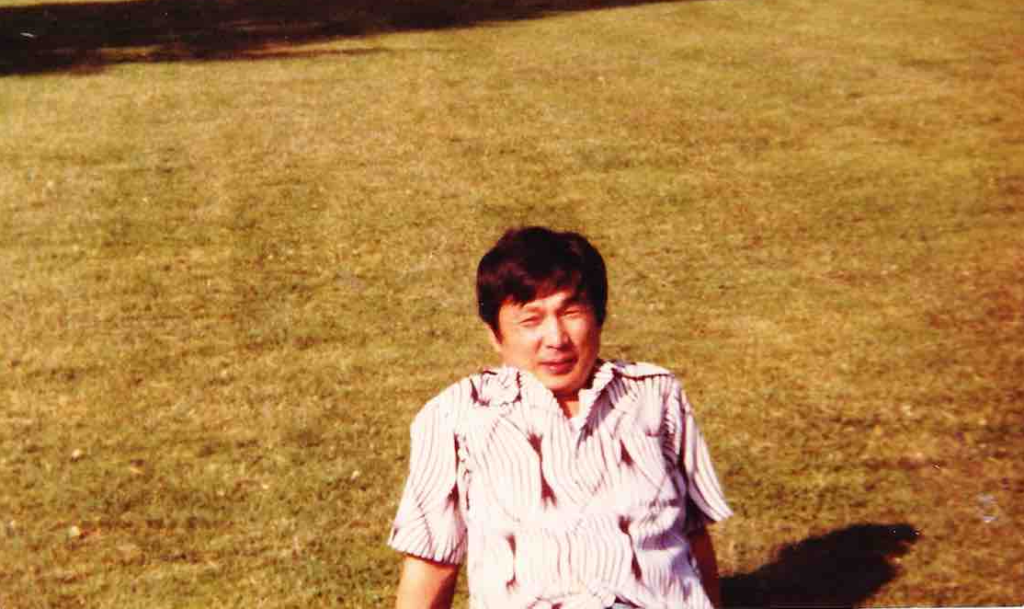 Dad sitting on lawn