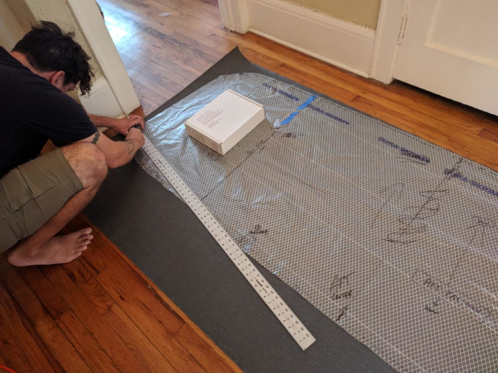 Tracing our bimini pattern onto the fabric.